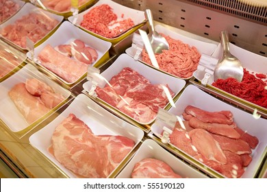 sale and food concept - meat in bowls at grocery stall