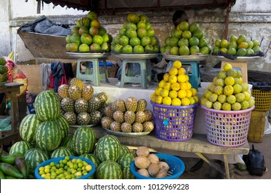 Sale of fruits and vegetables on the dirty street of a poor African city in republic of Ghana