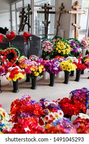 Sale of funeral accessories. Shop selling coffins, funeral wreaths and flowers