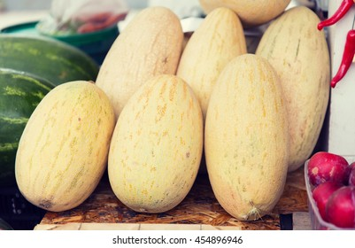 sale, harvest, food, fruits and agriculture concept - close up of melon at street farmers market