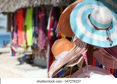 Sale of hats and clothes in a beach market at the Catalina Island in Dominican Republic