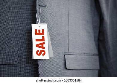 Sale label on new suit jacket close-up