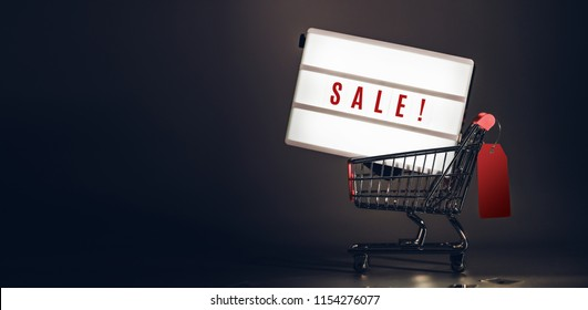 Sale light box in shopping cart with prize tag at dark studio room banner size.Mock up header leave space for adding text or design for promote business campaign on line