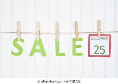 SALE on a Clothesline with a Christmas Calendar Page.  Holiday Concept.