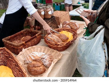 Sale of organic loaves at outdoor farmers market