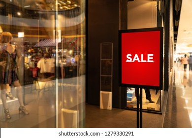 Sale poster for promotion mock up.Sale wording in front of retail store for marketing information.