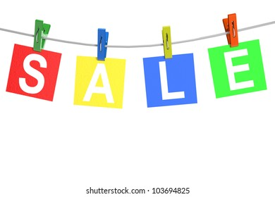 Sale price tags with  clothespin on a white background