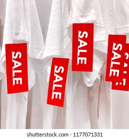 Sale Red Label Tag.Best price shopping offer.Discount sale promotion sign banner.Special to purchase symbol.End of Sale season shopping.White Shirt with Sale tag.