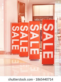 Sale red sign at mall. Discount concept. Market interior design. Selling business model. Lifestyle promotion. Store promo graphic. Shop background. Cheap boutique. Retail commercial price. Money offer