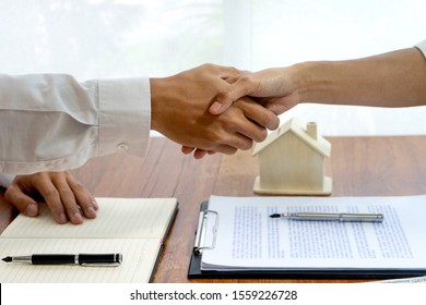 Sale representative or insurance broker handshake with customer after house purchase contract buy a house or apartment