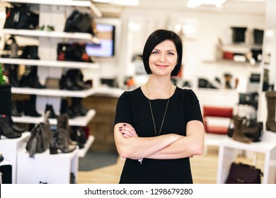 A sale, shopping and people concept happy young woman or shop assistant at store