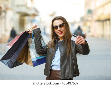 Sale, shopping, tourism and happy people concept - beautiful woman with shopping bags in the ctiy - Let's go shopping concept