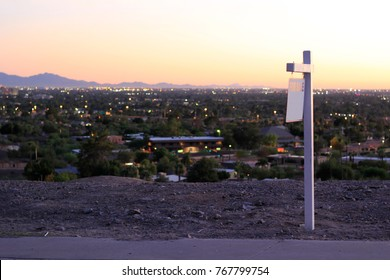 For Sale Sign Advertising a Real Estate Lot with a View Overlooking the Valley Skyline