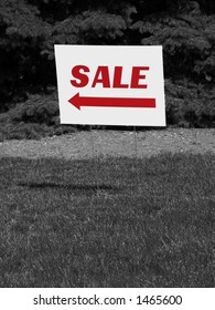 Sale sign with arrow and easy-to-add copy space. Red letters on black and white background.