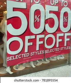 Sale sign banner hanging in shop front window for Christmas Boxing Day sales