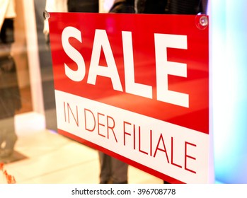 Sale sign with copy space in a shop window. Shopping mall with winter sale.