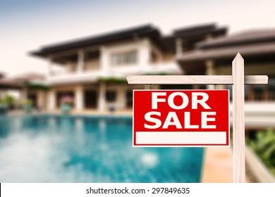 for sale sign at luxury house with pool background