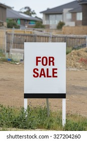 For sale sign on a vacant residential land