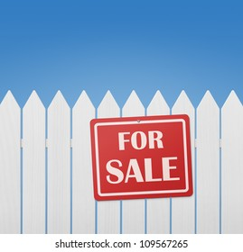 For sale sign on white wooden fence against the blue sky with copy space