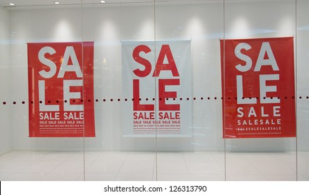 Sale sign text on wall in marketplace