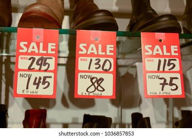 Sale sign in womens shoe store - with before and after sale pric