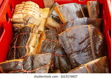 Sale of smoked Kamchatka fish. Far Eastern seafood, natural smoked fish - halibut salmon at the city Christmas market