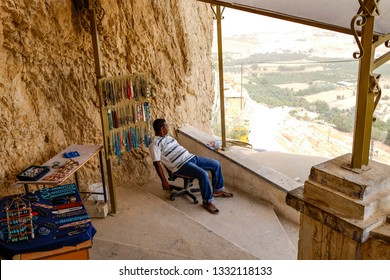 Sale of souvenirs in Monastery of the Temptation. Greek Orthodox monastery located on the cliffs near Jericho, Place of temptation of Christ. Palestine. 10-09-2015