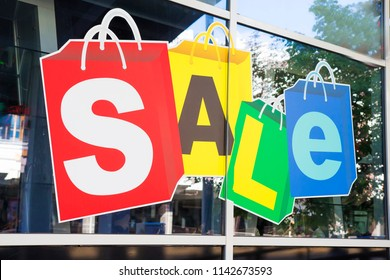 Sale in the store concept. The word SALE in the shop window. Black Friday in the boutique.