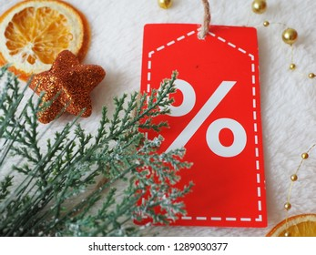Sale tag with green branch on festive background, Christmas