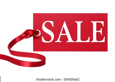 Sale tag or price ticket with red ribbon isolated on white.