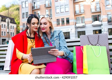 sale and tourism, happy people concept - beautiful women with shopping bags in the city