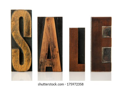 sale in vintage wooden print letters
