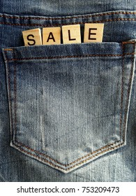 Sale writing protruding from jeans pocket