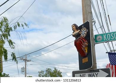 SALEM, MA, USA - AUG 15, 2014: Lady of Salem statue in Salem, Massachusetts, USA. The original figurehead was installed on antique ship Friendship of Salem.