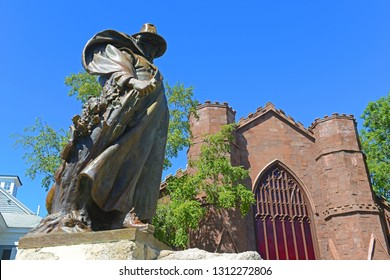 SALEM, MA, USA - SEP 7, 2014: Roger Conant statue in front of Salem Witch Museum in Historic downtown Salem, Massachusetts, USA.