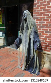 SALEM, MA, USA - SEP 7, 2014: Ghost figure in historic town Salem, Massachusetts, USA. Salem is famous for witch and ghost culture in history.