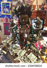 Salem, Massachusetts / USA - August 13, 2019  - Statue of Green Tara, a female figure in Tibetan Buddhism in store in Salem Massachusetts