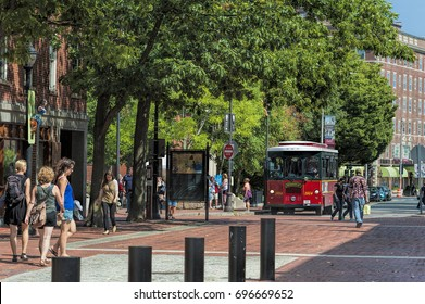 Salem, Massachusetts,USA - September 14, 2016: Downtown Salem Massachusetts walk pedestrians, mostly tourist and a trolley bus offers rides.