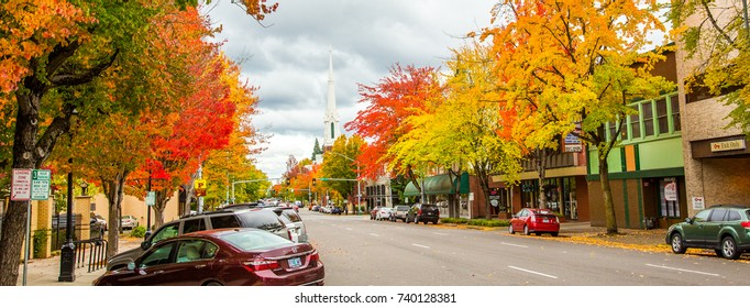 Salem, Oregon - 10/20/2017:  a street scene in downtown Salem with trees exhibiting brilliant fall colors and the Methodist church steeple showing in the background.