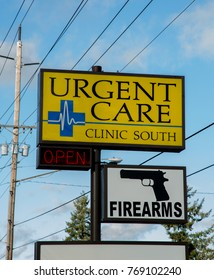 Salem, Oregon - 12/4/2015: Sign with Urgent care and firearms on the same post.  One stop shopping, buy a gun and get medical treatment at same location.