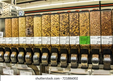 Salem, Oregon - August 23, 2017: Bulk food containers (dispensers)  full of various nut mixtures in a grocery store in Salem, Oregon