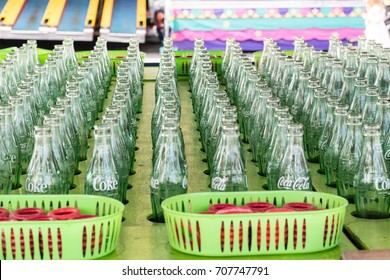 Salem, Oregon - August 29, 2017: Ring toss carnival, fair game using coca cola bottles.