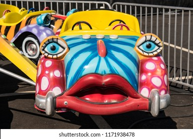 Salem, Oregon - August 30, 2018: Colorfully painted cars with funny human faces on children's ride at Oregon State fair.