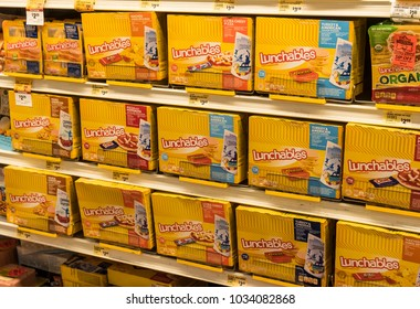 Salem, Oregon - February 24, 2018: Colorful packages of lunch time meals on shelves in boxes in a supermarket.