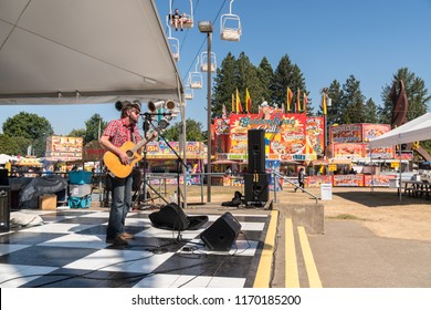 Salem, Oregon - September 6, 2018: Musician singing and playing guitar on stage at the Oregon State Fair.