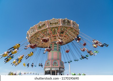 Salem, Oregon - September 6, 2018: Spinning, carousel amusement park ride at the Oregon State Fair.