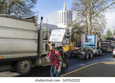 SALEM, OREGON / UNITED STATES - FEBRUARY 6, 2020: Protester with sign at Timber Unity rally in front of Oregon's capitol building. The rally was in protest of cap-and-trade legislation.