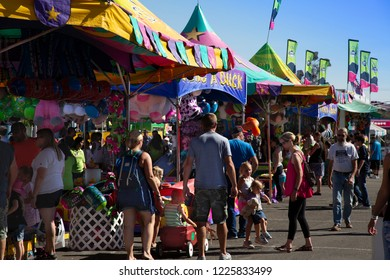 Salem, Oregon / USA - August 28, 2018: A view of the midway with people at game concession, daytime - Oregon State Fair