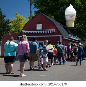 Salem, Oregon USA - July 10, 2021: A line of people at an ice cream concession stand at the Marion County Fair