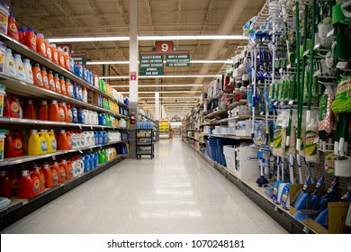 Salem, Oregon / USA - March 21, 2018: Laundry detergent, household cleaning products, and tools in supermaket aisle 9